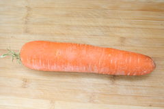 Carrot. Fresh carrot on wood background Royalty Free Stock Photography
