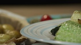 Healthy meal. Carrot almond truffles, healthy zucchinni salad stock video footage