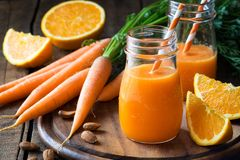Free Carrot And Orange Juice Or Smoothie Stock Photos - 127016303