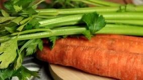 Carrot and apio stick - camera panning. Carrot and apio stick on cooking table - camera panning stock footage