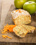 Carrot apple coffee cake with carrots. Carrot apple cake on wooden table with shredded carrots Stock Photos