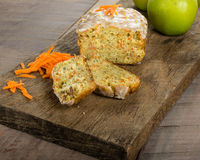 Carrot apple coffee cake with carrots. Carrot apple cake on wooden table with shredded carrots Royalty Free Stock Images