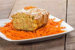 Carrot apple coffee cake with carrots. Carrot apple cake on wooden table with shredded carrots Stock Image