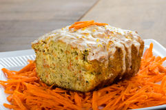 Carrot apple coffee cake with carrots. Carrot apple cake on wooden table with shredded carrots Stock Photo
