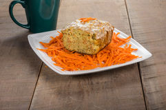 Carrot apple coffee cake with carrots. Carrot apple cake on wooden table with shredded carrots Royalty Free Stock Photo