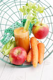 Carrot and apple juice Royalty Free Stock Photography