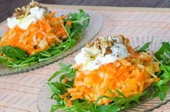 Carrot and apple salad with yogurt and walnuts Stock Photo