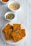 Carrot bars with oatmeal, dried apricots, seeds and honey royalty free stock photos