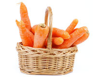 Carrot in Basket. Bunch of Fresh Raw Carrot in Wicker Basket isolated on white background Royalty Free Stock Photo
