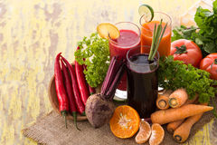 Carrot, Beet and Red Chili pepper mix juice Stock Photos