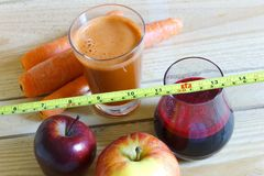 Carrot and beetroot juice and vegetables stock image