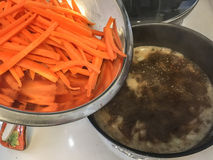 Carrot and boiling broth Stock Photo