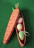 Carrot box with Easter eggs inside Stock Image