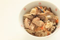 Japanese winter food, chicken and Maitake mushroom rice. Carrot and broth for homemade comfort food image stock photos