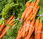Carrot bunches. Fresh carrots for sale at the Clement Street Farmer's Market in San Francisco stock photo