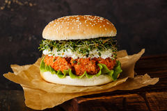 Carrot burger with clover sprouts Royalty Free Stock Photo