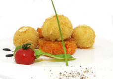 Carrot burgers with potato balls Royalty Free Stock Photos