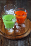 Carrot and cactus juice. Assortment of juice: carrot and cactus Royalty Free Stock Images
