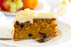 Carrot Cake. With cake fork. Healthy fruit behind royalty free stock photos