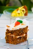 Carrot Cake. Slice of carrot cake. Lemon cake in the background Royalty Free Stock Images