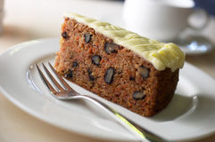 Carrot cake. With cake fork. Healthy fruit behind stock photo
