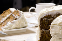 Carrot Cake. A slice of fresh carrot cake with a cup of coffee Royalty Free Stock Images