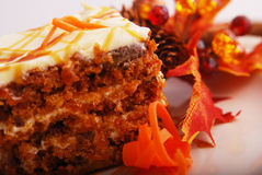 Carrot cake. On a plate garnished with autumn leaves Royalty Free Stock Photos