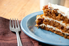 Carrot cake on a blue plate with milk and fork Royalty Free Stock Images