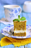 Carrot cake with butter and ricotta cream. Royalty Free Stock Image