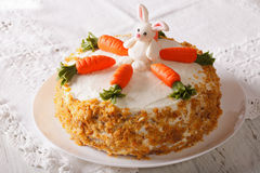Carrot cake with candy bunny close-up on the table. horizontal Stock Photo