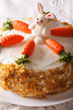 Carrot cake with candy bunny close-up on the table. Vertical Royalty Free Stock Photos