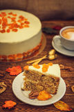 Carrot cake with cappuccino on wooden background stock photos