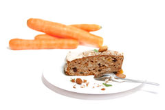Carrot cake with carrot. On isolated white background royalty free stock image