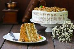 Carrot cake. With walnuts and mascarpone cream royalty free stock photo