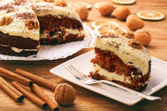 Carrot cake with cheese cream on brown table. Carrot cake with cheese cream on brown table royalty free stock photography