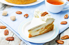 Carrot cake cheesecake with pecan Stock Images