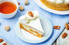 Carrot cake cheesecake with pecan Stock Image