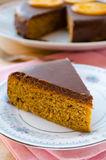Carrot cake with chocolate topping and caramelized oranges Royalty Free Stock Image