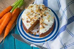 Carrot cake and cloth on table with carrots. Carrot cake and cloth on table with fresh carrots Royalty Free Stock Photos