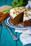 Carrot cake and cloth on table with  carrots. Carrot cake and cloth on table with fresh carrots Royalty Free Stock Images