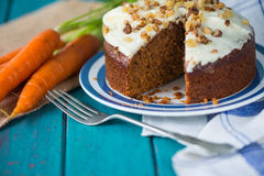 Carrot cake and cloth on table with carrots. Carrot cake and cloth on table with fresh carrots Stock Photo