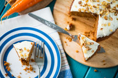 Carrot cake and cloth on table with carrots. Carrot cake and cloth on table with fresh carrots Royalty Free Stock Photography