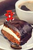 Carrot cake with coffee and teddy bear pick Royalty Free Stock Photos