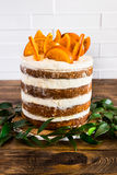 Carrot cake with cream cheese decorated with caramel oranges Stock Photography