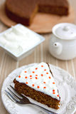 Carrot cake with cream cheese frosting Royalty Free Stock Photos