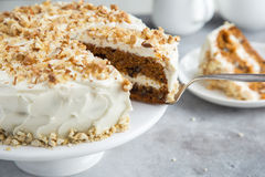 Carrot cake with cream cheese frosting and nuts Stock Photos