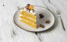 Carrot cake with cream cheese, nuts, berries and tangerines Royalty Free Stock Photography