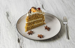 Carrot cake with cream cheese, nuts, berries and tangerines Stock Photography