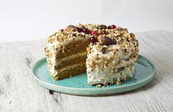 Carrot cake with cream cheese, nuts, berries and tangerines Royalty Free Stock Photos
