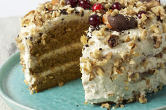 Carrot cake with cream cheese, nuts, berries and tangerines Royalty Free Stock Photo